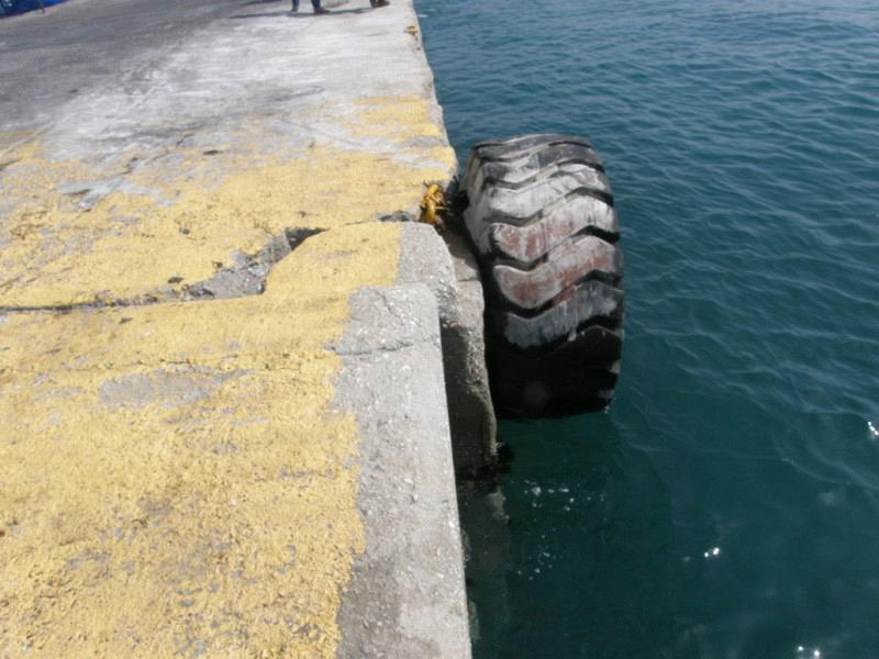 Photo 6. Suspended used rubber track tires as marine fenders in a quay wall (Port of Naxos - 2010)