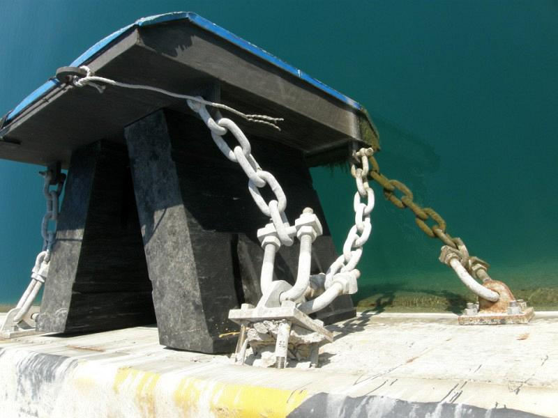 Photo 8. In the photo is shown a V type fender with contact panel and shear chains with failed anchor system after ship collision (Port of Souda, Crete - 2011)